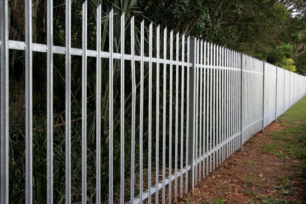 an iron white fence