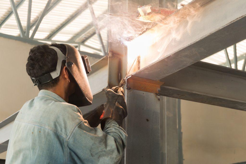 man welding a metal